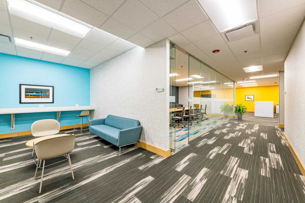 Interior office design with distinct separated sections